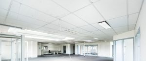 Empty office space with suspended ceiling