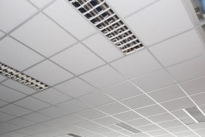 Suspended ceiling with LED square lamps sin the office close-up